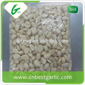 White pure peeled frozen garlic cloves